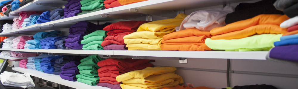 a shelf of shirts